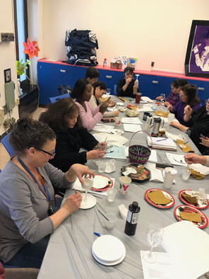 P176X School Leadership Team painting glasses
