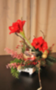 Kerststuk door Natys Floral Design & Services