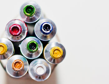 Watercolor paint tubes of different colours