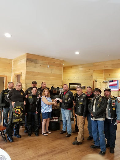 Chapter 17-2 presenting a donation to House in the Woods, 2017
