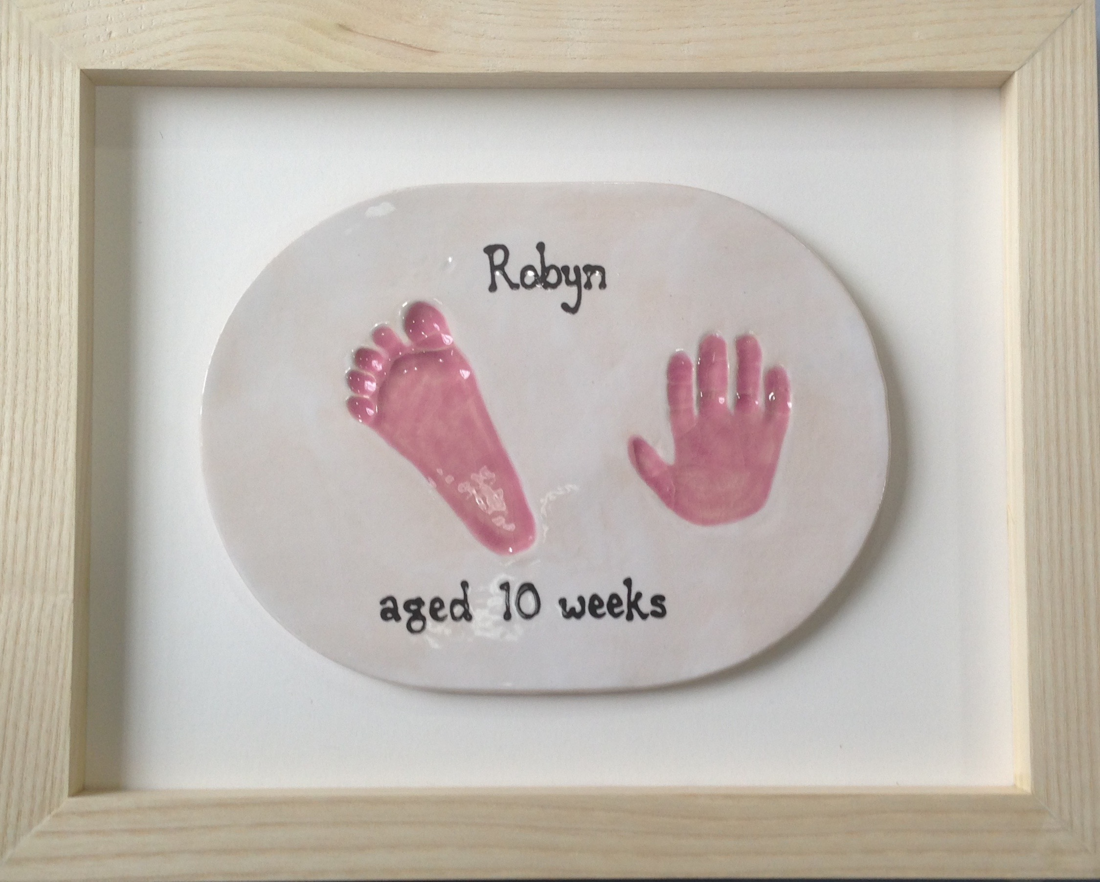 Framed baby hand and footprint