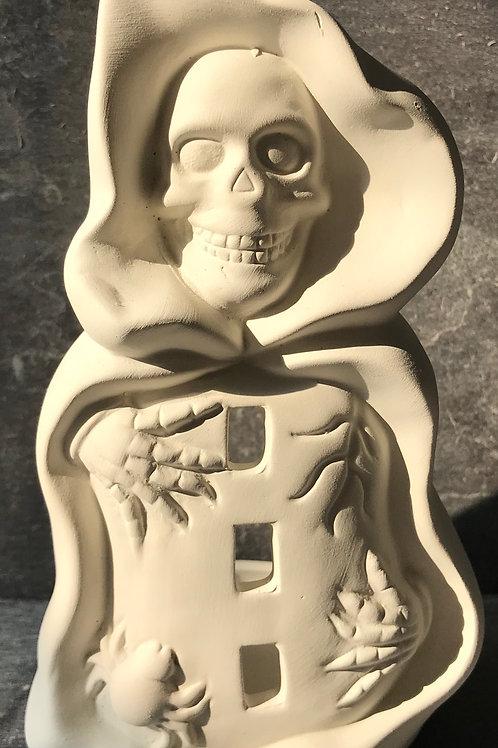 Caped skeleton tea light holder