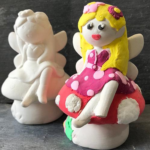 Fairy on toadstool money bank