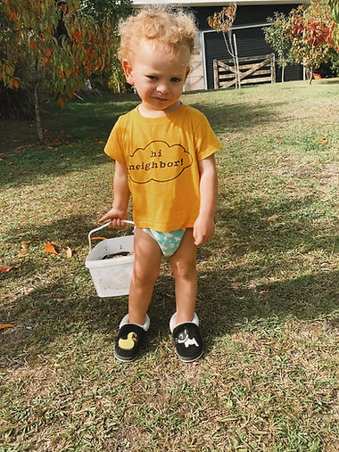 Blonde Kid in a yellow shirt
