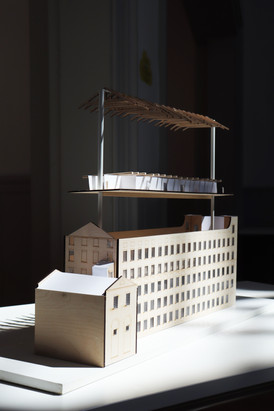 At scale 1:100 and in exploded view, my model demonstrates the interaction between the existing building envelope and my design intervention; the roof trusses and window pane detailing compliment the elegant internal walls that subdivide the apartments. The materiality of the model echoes the finishes found within the scheme.