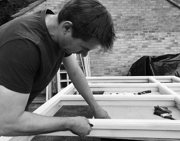 Robert Forster is a joiner and is seen working on a new wooden sash window