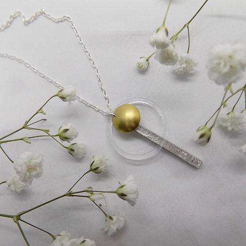Geo with brass necklace