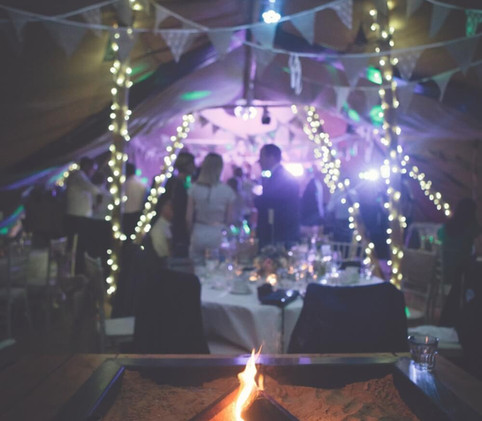 tipi lights fire pit wedding party north