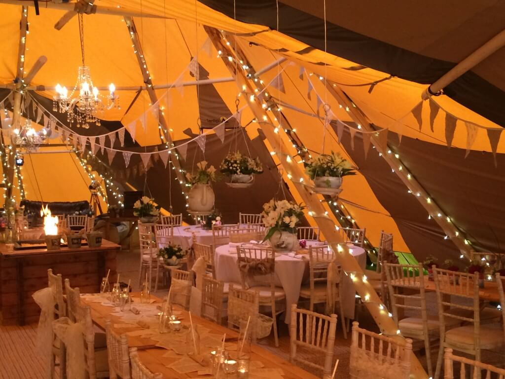 tipi fairy light poles hanging tea cups