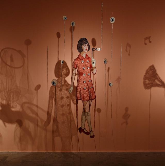 Suspended embroidery installation at Caixa Cultural Brasília