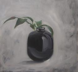 black vase with twig