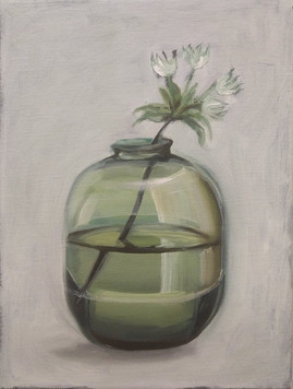 green transparent vase with flower