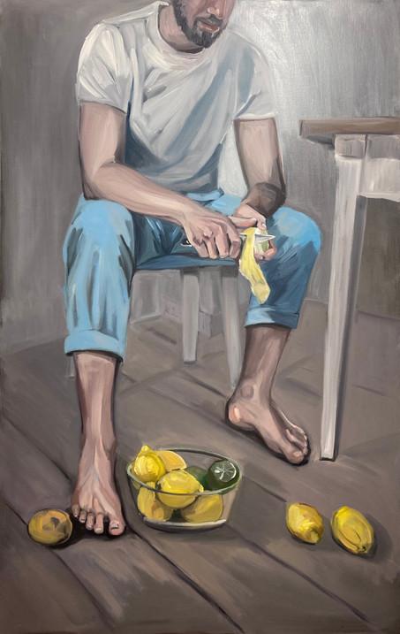 men pilling lemons