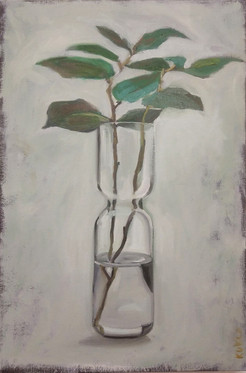 transparent vase with twig with leaves