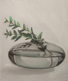 gray transparent vase with twig
