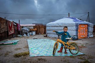 Mongolia The kid on the bike