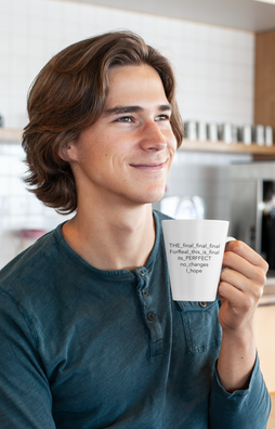coffee-mug-mockup-of-a-smiling-young-man