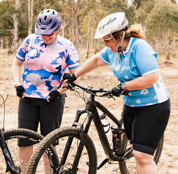 Two female MTB riders wearing raw gear Tour de Femme and Bluebelle cycling jeseys