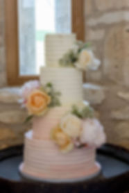 buttercream 4 tier wedding cake - fresh flowrs