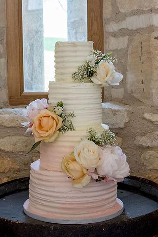 buttercream 4 tier wedding cake - fresh flowrs