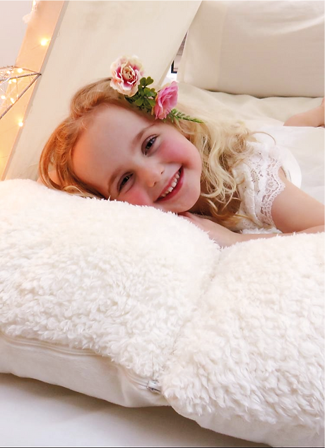 Smiley flower girl in small wedding guest teepee tent