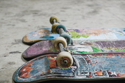 3 skateboards lean up against each other