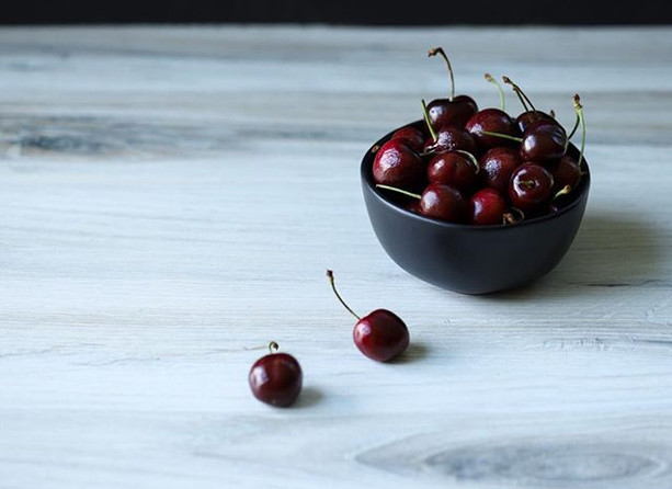 A bowl full of cherries. Whether it was