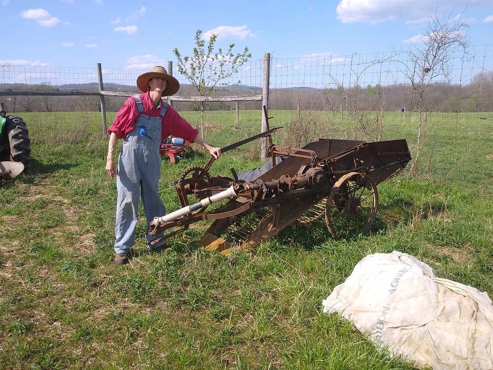Mark Canright next to his antique potato planter.