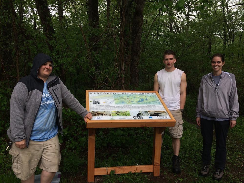 MWA summer interns next to interpretative sign at Riverside Park, Byram Township