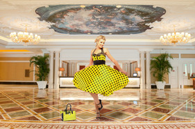 Girl dancing in hotel lobby by Peter Pickering Photography