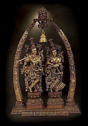 Radha-Krishna Statues Within An Aureole Engraved With Krishnaleela Episodes