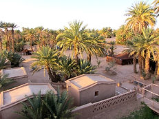 The Nwalla Huts are adobe bedrooms outside in the garden