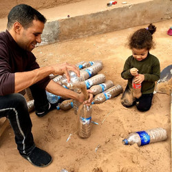 boudi and rahma filling bottles