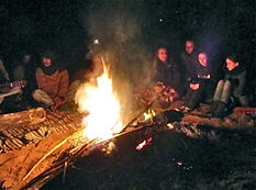 Sitting around the campfire at the camp