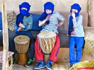 The children love the desert drums