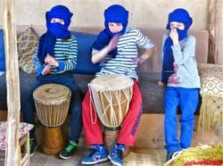 The children love the desert drums