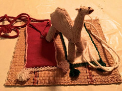 one of the knitted camels