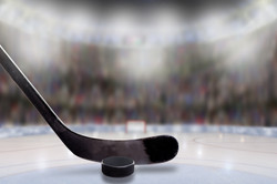Low angle view of hockey stick and puck