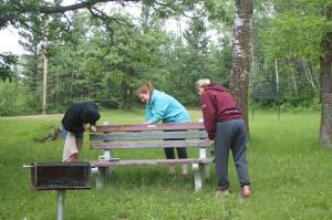 Delegates to the 2014 International Peace Garden spruce up the Maple Picnic Area, a park that has been sponsored by the Manitoba WI and FWIC since 1951.