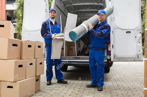two-delivery-men-holding-chairs-and-carpet-R6AD26_edited.jpg