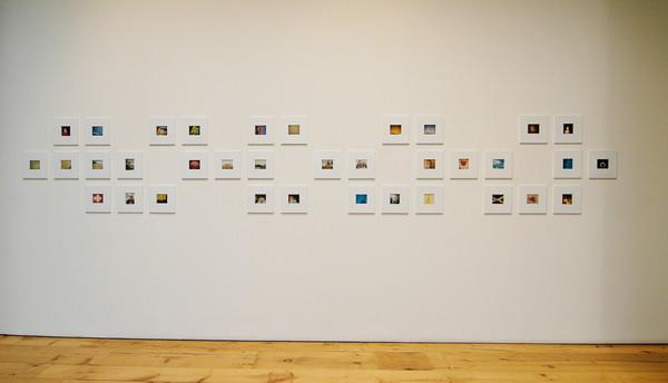 Polaroids_white_wall