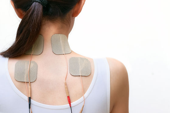 Patient woman is doing massage of electrical stimulation ( TENs ) for the neck and upper b