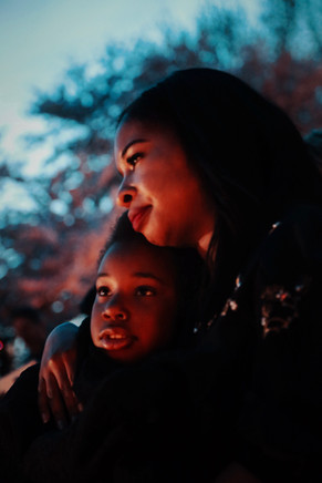 Martin Luther King, Jr.'s granddaughter hugged by mother at a vigil for 51st commemoration of Martin Luther King, Jr.'s assasination