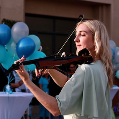 Violinist performing at corporate event
