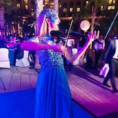 Electric violinist performing at Atlantis Dubai