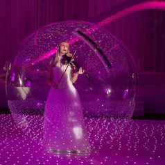 Violinist performing in a bubble for event