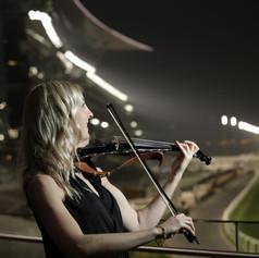 Violinist at meydan racecourse in Dubai