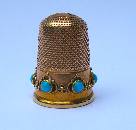 Thimble, gold set with turquoise.
