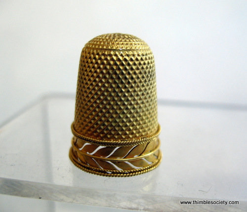 Gold thimble with pierced leaf design