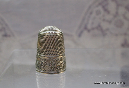 Silver thimble, central shield